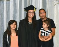 LLTC student with family at graduation ceremony