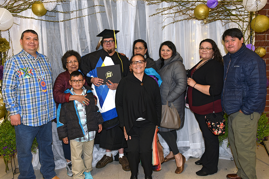 LLTC student at graduation ceremony with family